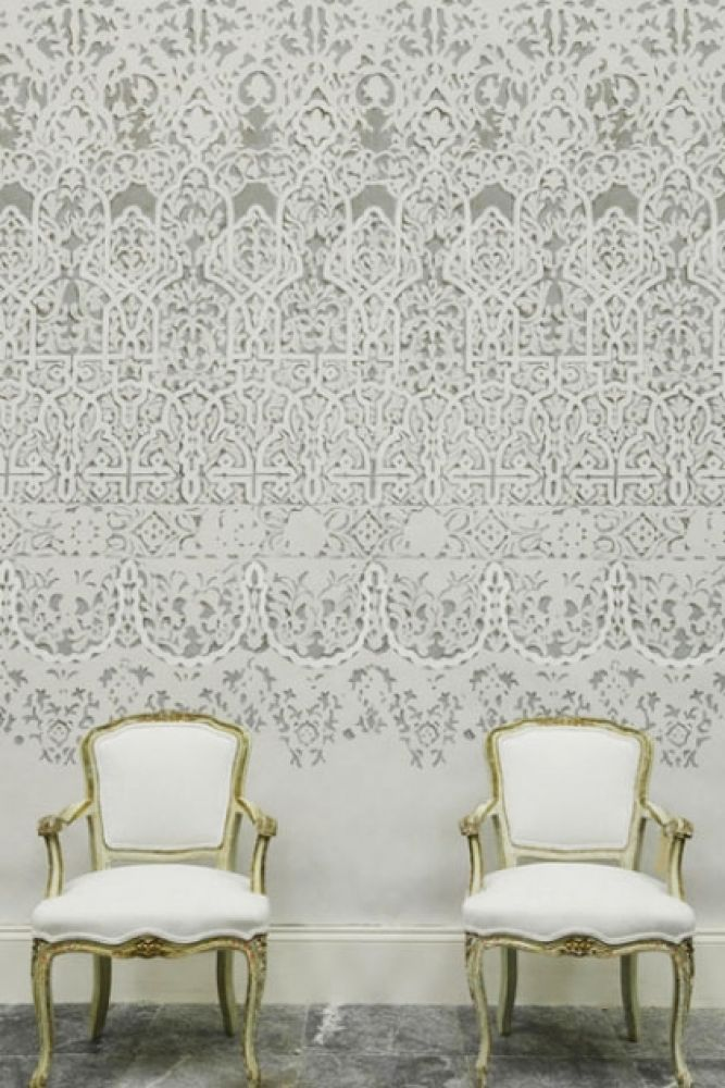 lifestyle image of lewis & wood petra wide Wallpaper mural - 4 colours available with two green and white chairs