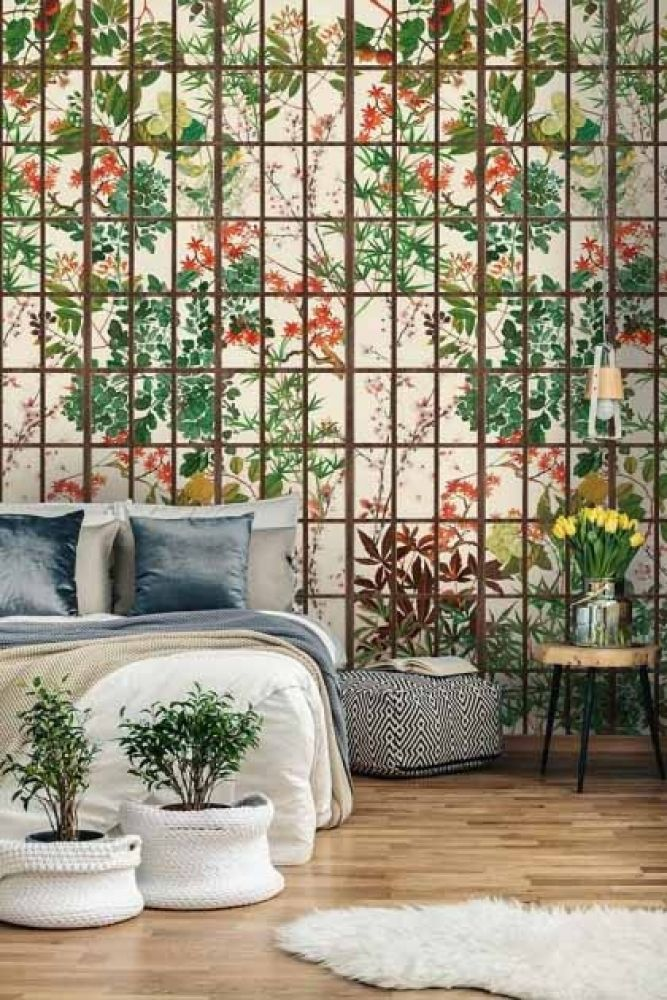 Lifestyle image of the natural version of the Japanese Garden wallpaper in a bedroom setting with double bed and two plants in white pots and round rug in foreground
