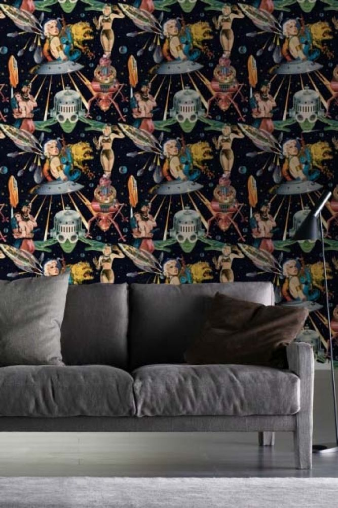 lifestyle image of mind the gap other worlds wallpaper with grey sofa and dark cushions