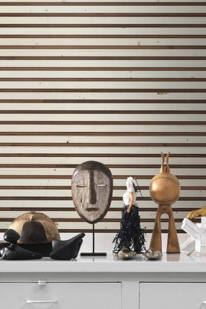 lifestyle image of NLXL TIM-03 Timber Strips Wallpaper by Piet Hein Eek with white table with Moroccan style ornaments on top