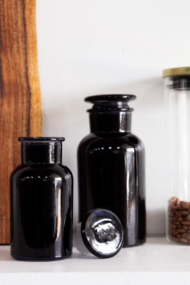 Lifestyle image of the Set of 2 Inky Black/Blue Apothecary Bottle - Small & Large