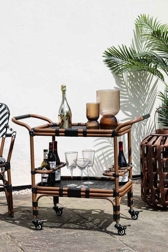 Lifestyle image of the Alfresco Rattan Outdoor Bar Drinks Trolley