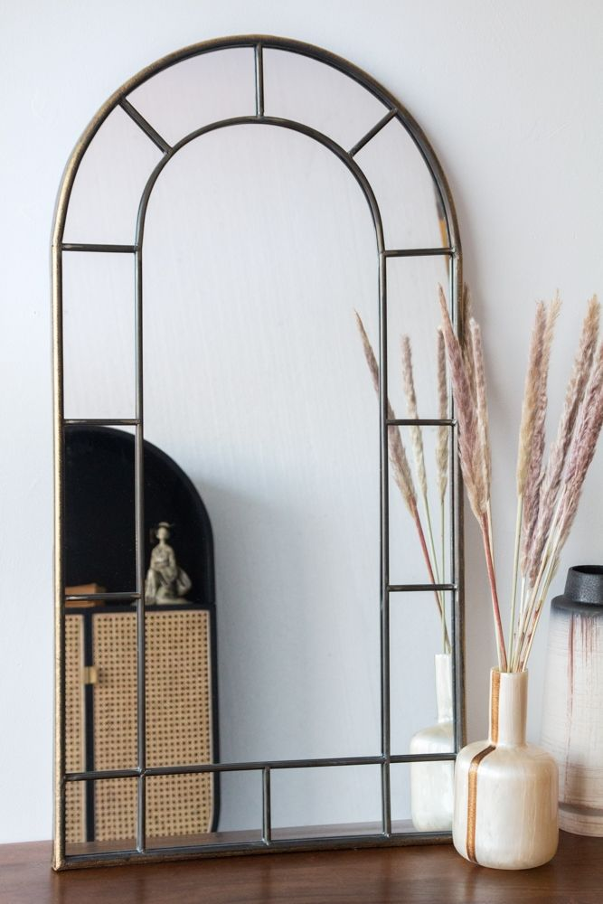 Lifestyle image of the Antique Gold Arched Window-Style Mirror
