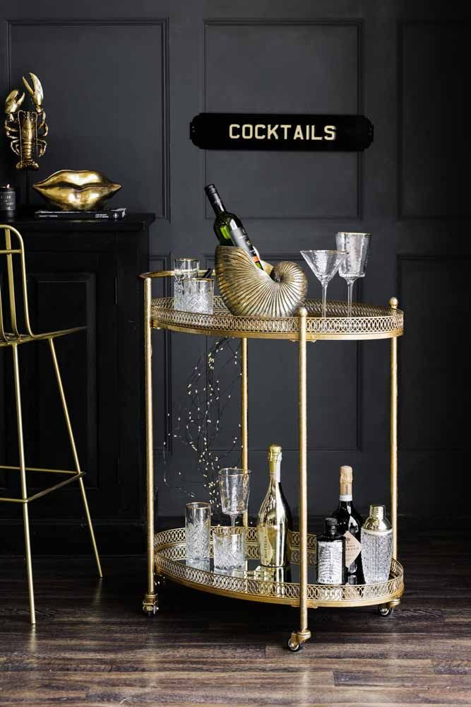 Lifestyle image of the Antique Style Gold Metal Drinks Trolley