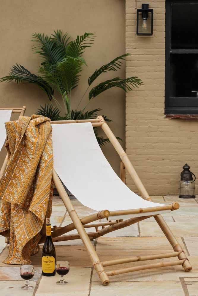 Lifestyle image of the Bamboo Deck Chair With Linen Seat