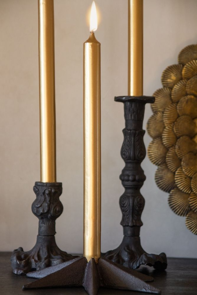 Image of 3 lit Metallic Gold Beautiful Dinner Candles in candlestick holders