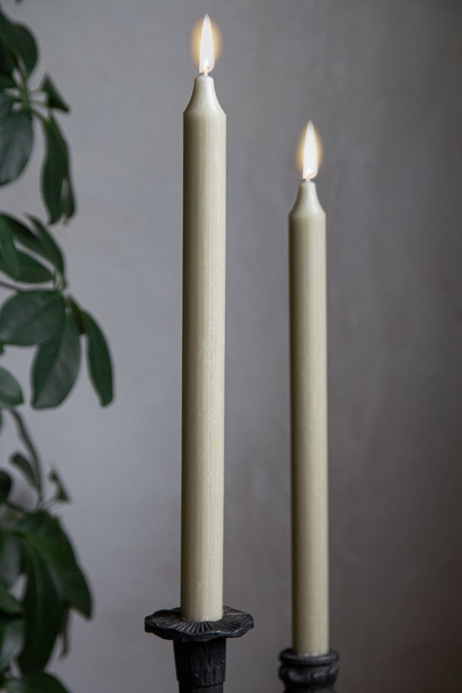 Image of 2 lit Sage Green Beautiful Dinner Candles