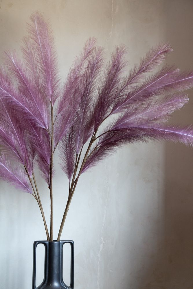 Close-up lifestyle image of 3 Mauve Faux Pampas Grass Stems in a vase