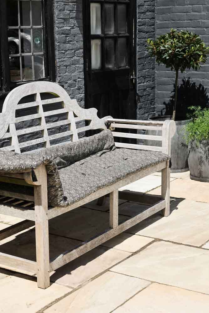 Image of the Garden Lounger Cushion With Flower Print folded on a chair