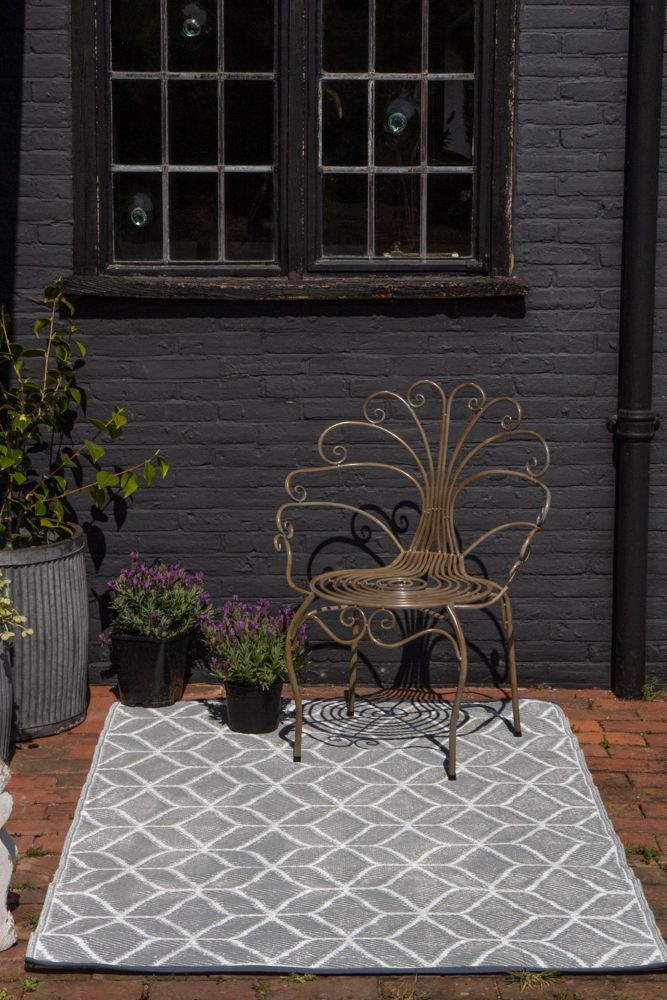 Lifestyle image of the dark side of the Geo Pattern Reversible Outdoor Garden Rug