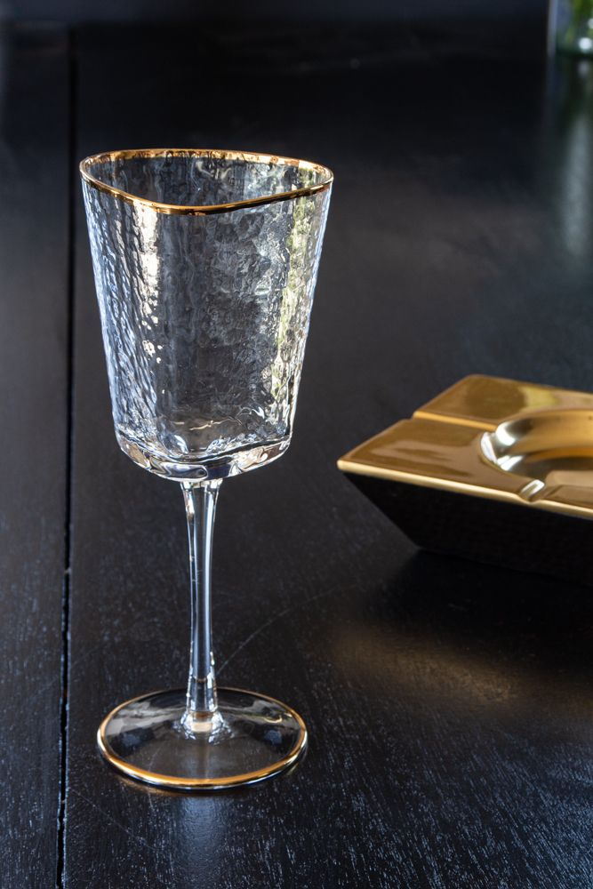 Lifestyle image of the Organic Wine Glass With Gold Rim