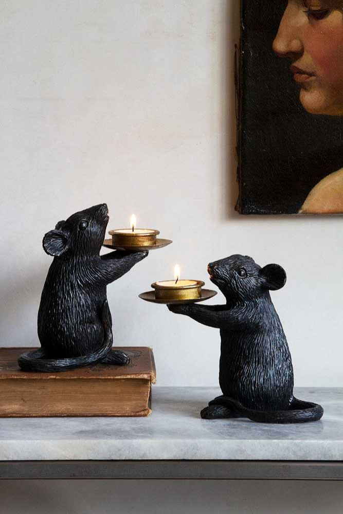 Lifestyle image of the Pair Of Black Mouse Candle Holders
