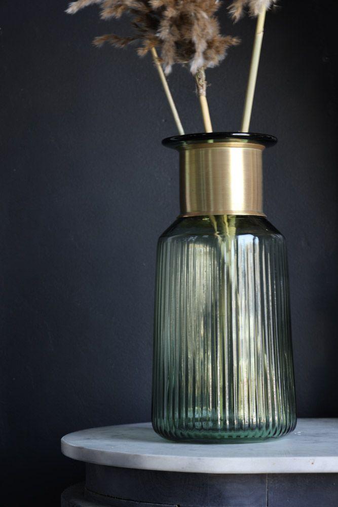 lifestyle image of Gold Neck Green Tinted Glass Bottle Vase
