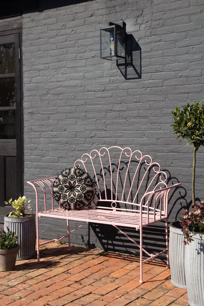Angled image of the Pretty Pink Metal Garden Bench