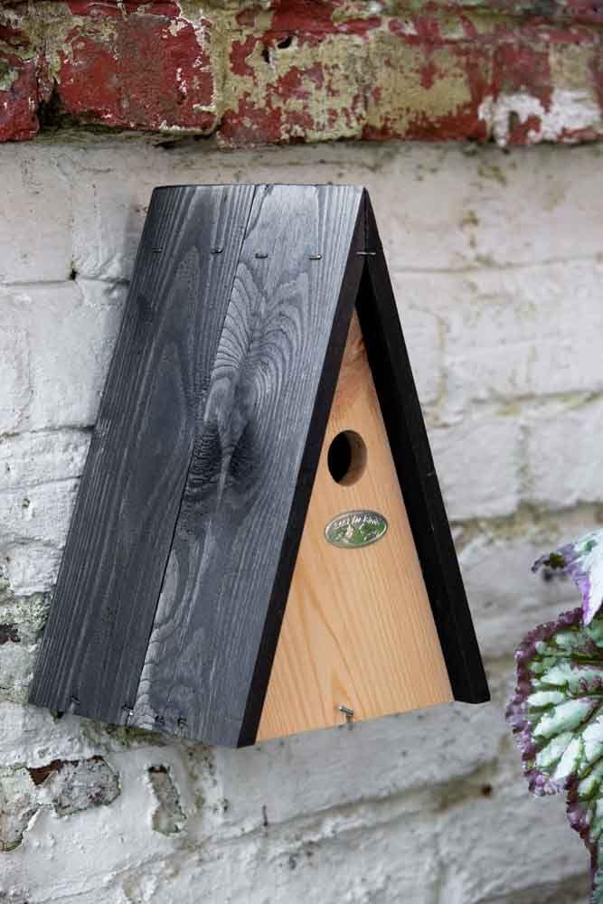 Lifestyle image of the Pyramid Bird House Nesting Box