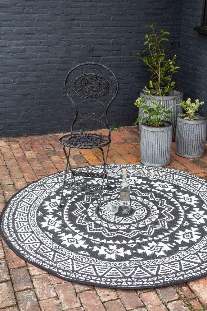Image of the darker side of the Round Aztec Design Reversible Outdoor Garden Rug