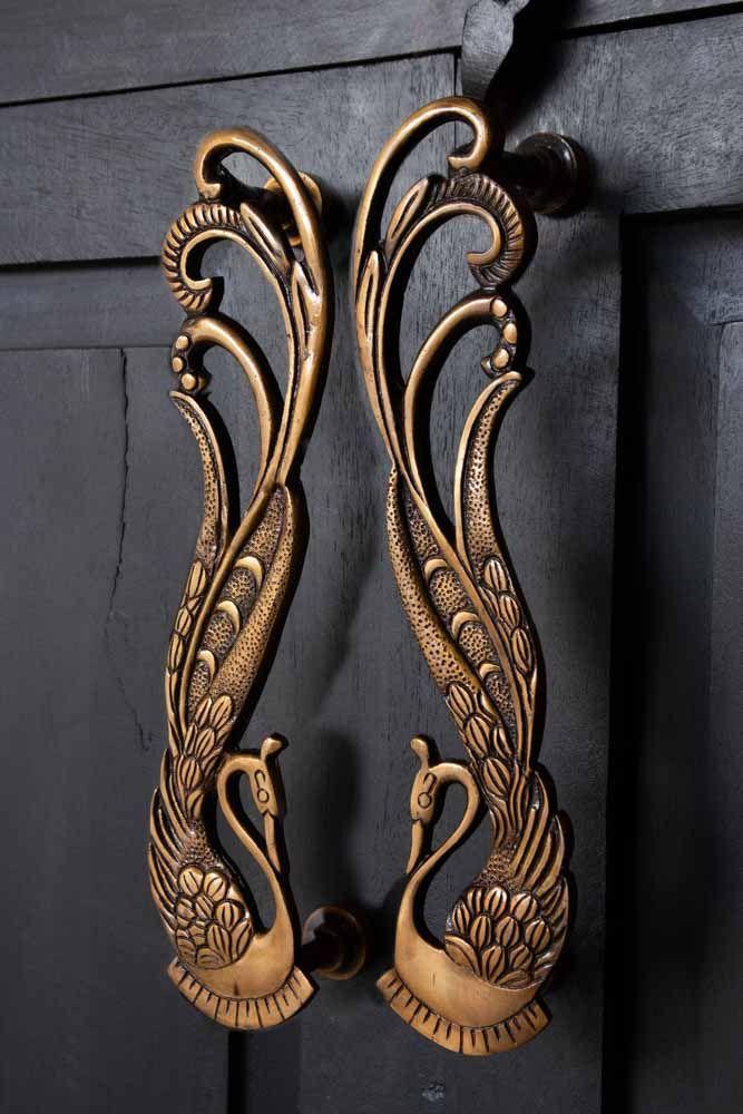Image of Set Of 2 Art Deco Brass Swan Door Handles on a cupboard