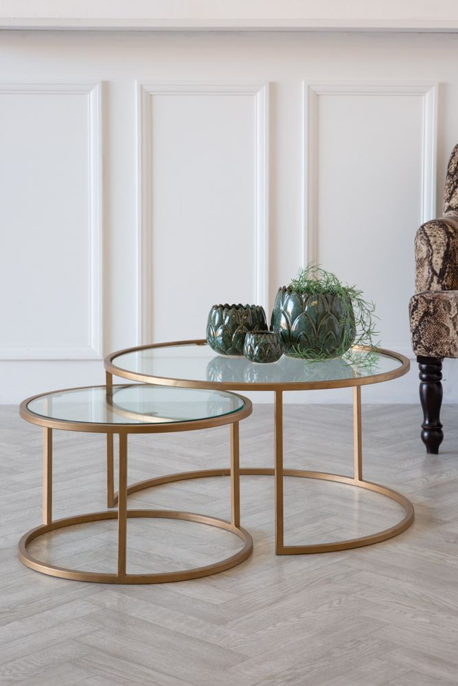 Lifestyle image of the Set Of 2 Circular Glass & Brass Coffee Tables
