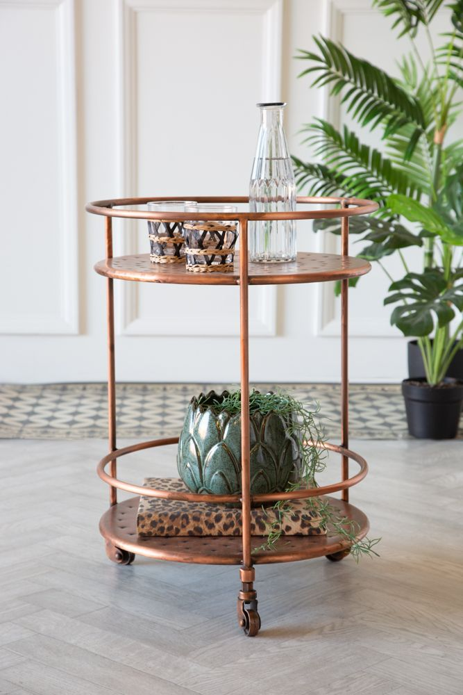 Lifestyle image of the Antique Copper Shoreditch Drinks Trolley in a light background