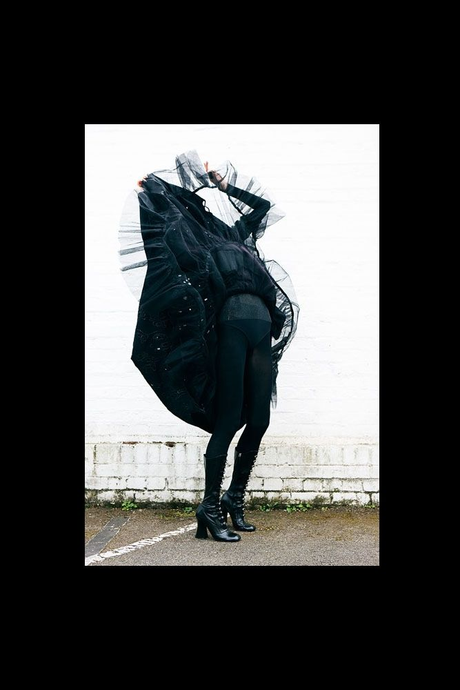 cutout image of Challenge Limited Edition Metallic Print by Diana Gomez editorial woman in extravagant black outfit on black background