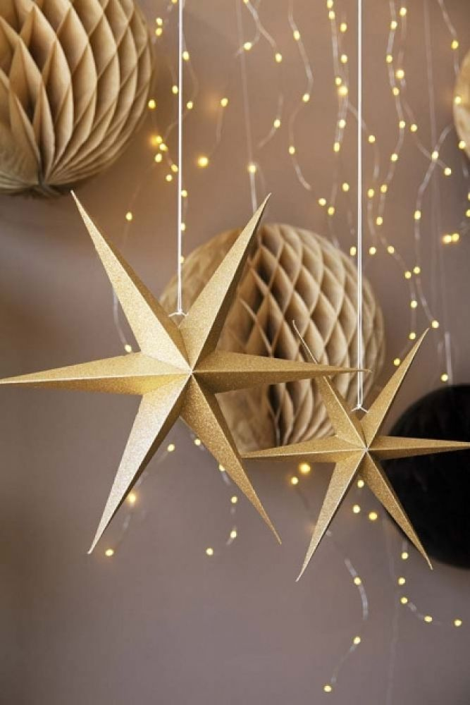 Image of the Set Of 2 Gold Glitter Star Decorations with honeycomb decorations in the background
