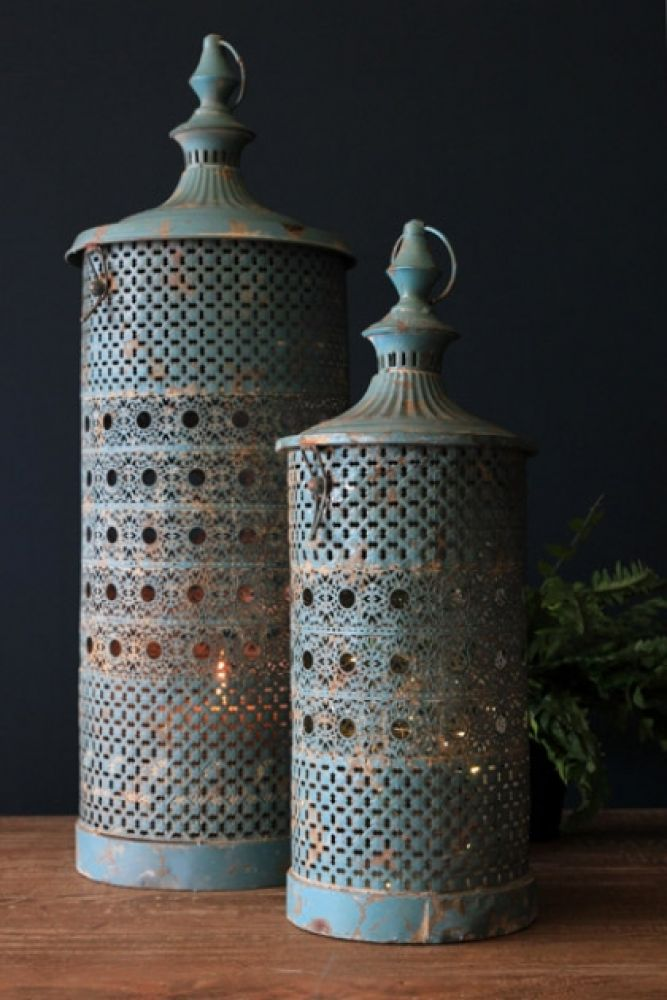 set of 2 rhiad blue lanterns on wooden table and dark background lifestyle image
