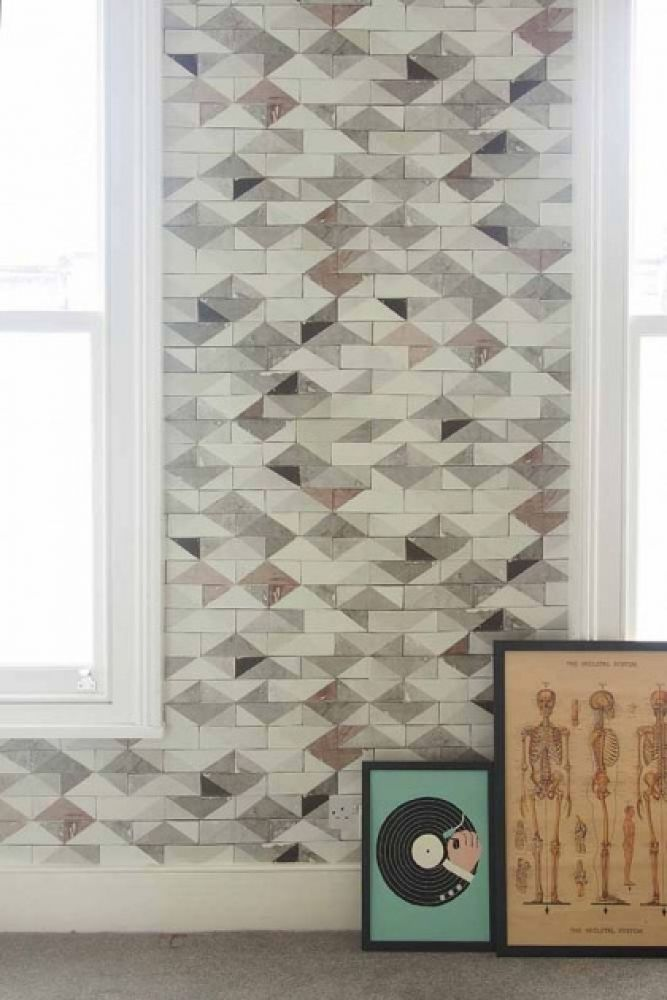 lifestyle image of smink things going overground tile wallpaper with windows and picture frames leaning against wall