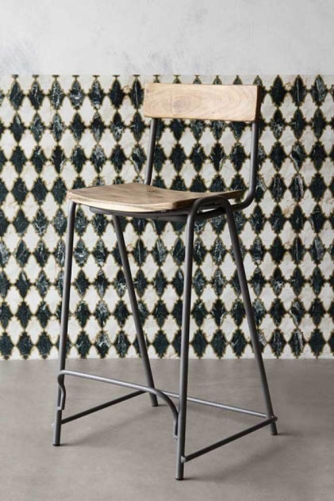 lifestyle image of the entire soho bar stool on checked background