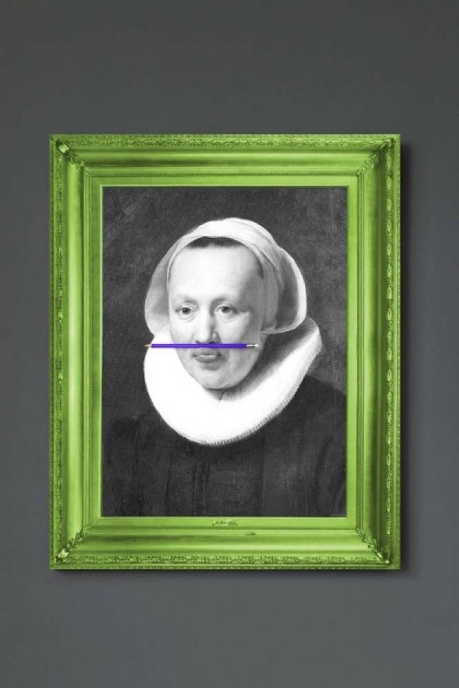 lifestyle image of the purple pencil canvas with printed frame black and white portrait with purple pencil in mouth and green frame on grey wall background