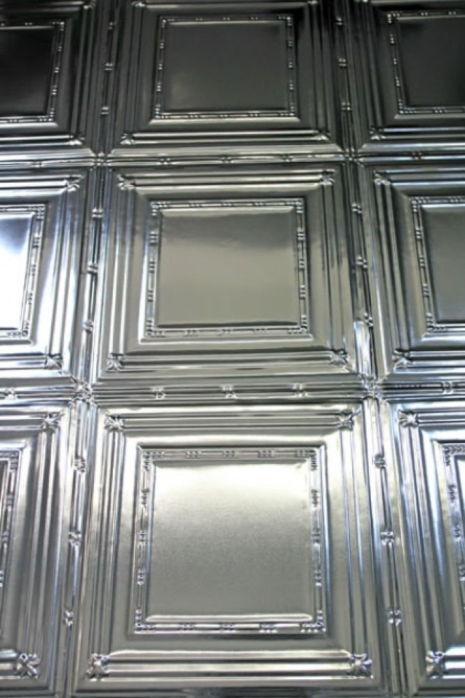 lifestyle image of multiple of traditional tin tile on wall
