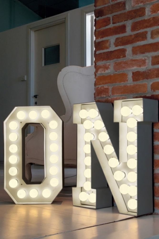 lifestyle image of vegaz style large metal letter with led lights o and n with brick wall in background