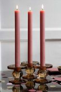 Image of the Pink Rustic Dinner Candle on a table and lit