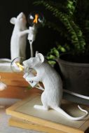lifestyle image of Porthos The Sitting Mouseketeer Lamp - White with other mouse lamp on pile of books with plant in black pot