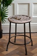 Lifestyle image of the Artisan Stool With Carved Floral Wooden Seat