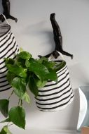 Image of the Black & White Stripe Storage Basket - Small with a faux plant