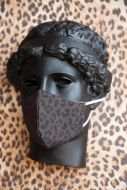 Close-up lifestyle image of the Black Cheetah Face Mask on a bust
