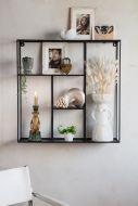 Front on lifestyle image of the Black Quadratic Shelf Unit
