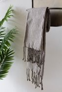 Image of the Black Striped 100% Cotton Hammam-Style Hand Towel With Fringe hanging on a rail