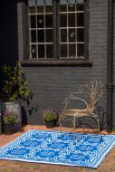 Lifestyle image of the dark side of the Blue Mosaic Reversible Outdoor Garden Rug