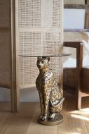 Lifestyle image of the Antique Gold Leopard Side Table With Glass Top