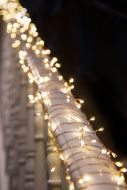 Image of the Copper Cluster Light Chain wrapped around a banister