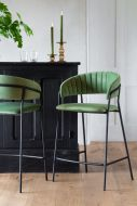Image of 2 of the Curved Back Velvet Bar Stools In Moss Green, one facing forward & one back