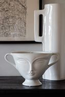 Lifestyle image of the Double Handle Two Face Lady Plant Pot