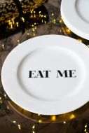 Image of the Eat Me Fine China Plate on a festive dinner table