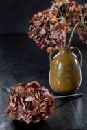 Lifestyle image of the Faux Hydrangea Stem In Rustic Red