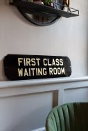 Angled image of the First Class Waiting Room Metal Sign Wall Art