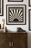 Lifestyle image of the Framed Sunrise Art Print hanging on the wall