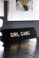 Angled image of the Girl Gang Metal Sign Wall Art
