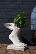 Lifestyle image of the Large Rustic Stone Effect Winged Foot Planter