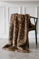 Image of the Light Faux Fur Leopard Print Throw over a chair
